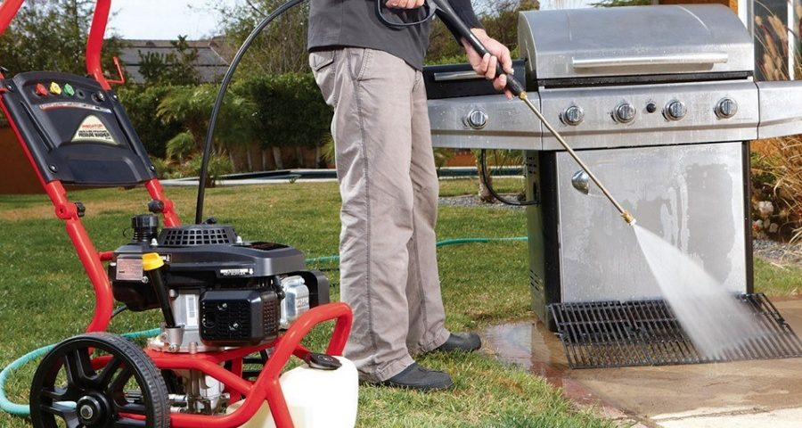 A man clean the gas pressure Washer